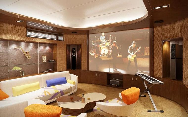 <p>Автор проекта: Гарольд Мосолов</p> <p>Просторная комната для отдыха оборудована домашним кинотеатром и дизайнерской мебелью ярких цветов. Хозяин дома оказался не только киноманом, но и меломаном, поэтому авторы проекта нашли место для синтезатора, а также коллекции музыкальных инструментов, которые выставили в специально оборудованном стеллаже.</p>