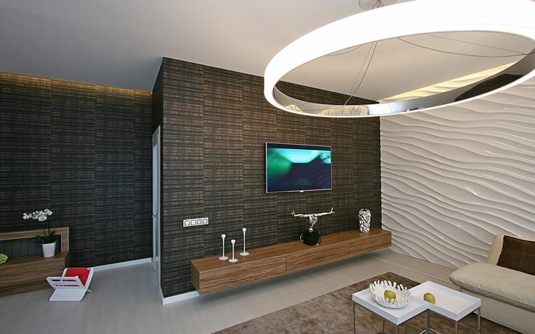 <p>Автор проекта: Архитектурная мастерская SVOYA studio.&nbsp;</p> <p>Акцент сделан на центр гостиной, как и положено в традиционном японском доме.Приглушенная монохромная гамма интерьера и низкая мебель тоже соответствует японскому стилю.</p>