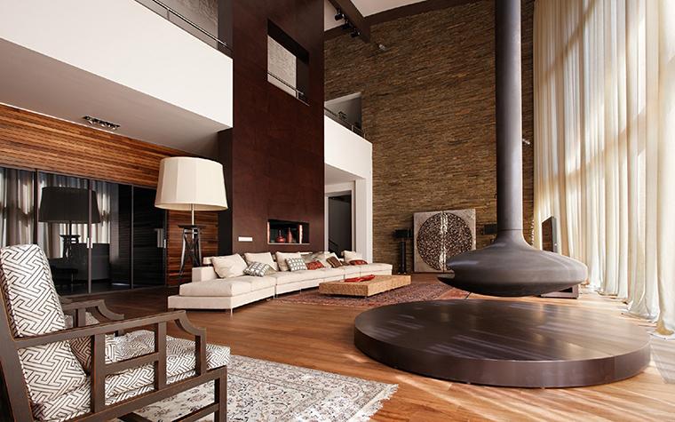 <p>Автор проекта: Роман Леонидов</p> <p>Большой секционный диван, расположенный в открытой гостиной напротив панорамного окна, можно использовать по-разному: как горизонтальный, полукруглый, так и угловой.</p>