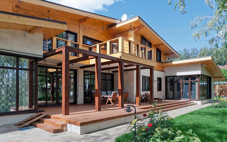 Загородный дом с террасой барбекю облицовка барбекю гибким камнем