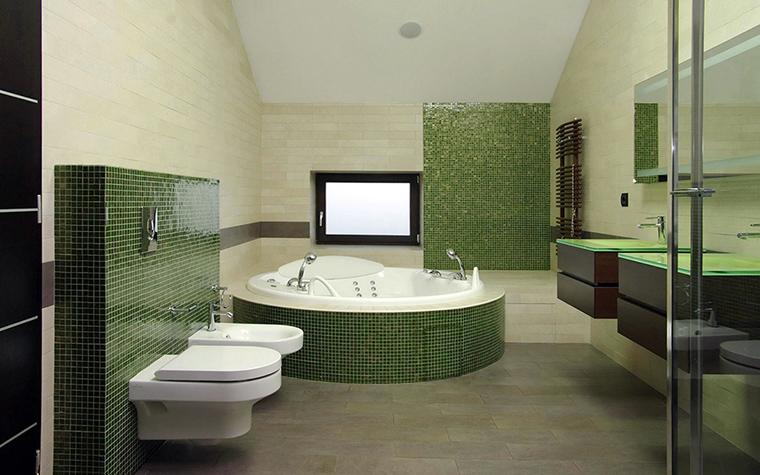 <p>Автор проекта: Погорельчук Владимир</p> <p>Стены ванной комнаты отделаны плиткой двух цветов: серо-салатового и ярко-зеленого. Пятна зеленого цвета распределены равномерно. Зеленой плиткой облицованы часть стен и бортик круглой джакузи. </p>