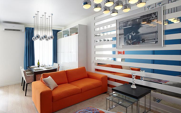 <p>Автор проекта: &laquo;Дизайн в кубе&raquo;.&nbsp;Фотограф: Дмитрий Лившиц</p> <p>Яркий оранжевый диван в данном случае, определяет границы между столово-кухонной и гостиной зонами. Граница хорошо видна!</p>
