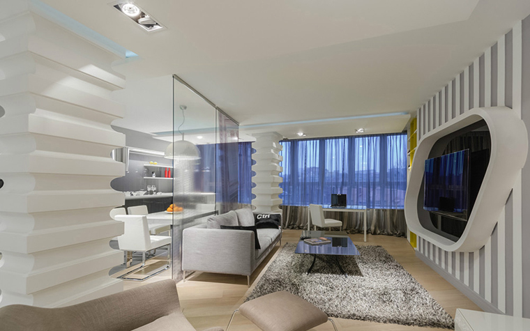<p>Автор проекта: Марина Кутузова.&nbsp;</p> <p>Современный стиль - и в стеклянных перегородках, огромных окнах, и многочисленных конструкциях. Много света и воздуха - это тоже признак современного интерьера. </p>