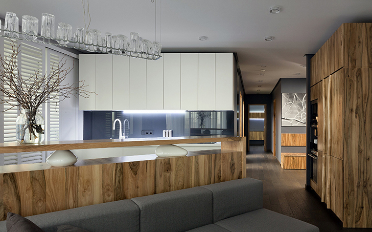 <p>Автор проекта: творческая мастерская Ryntvt Design.</p> <p>Идеальный вариант оформления кухни в эко-стиле — отделка  фасадов корпусной мебели деревом и включение в интерьер композиций из веток.</p> <p>&nbsp;</p>