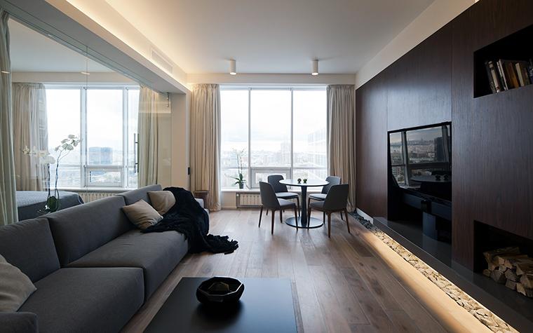 <p>Автор проекта: SL project<br /> Фотограф: Илья Иванов</p> <p>Камин в квартире многоэтажного дома с видом на Москву - это роскошь! Стиль камина столовой-гостиной такой же, как весь интерьер, - то есть современный, с привкусом минимализма.</p>