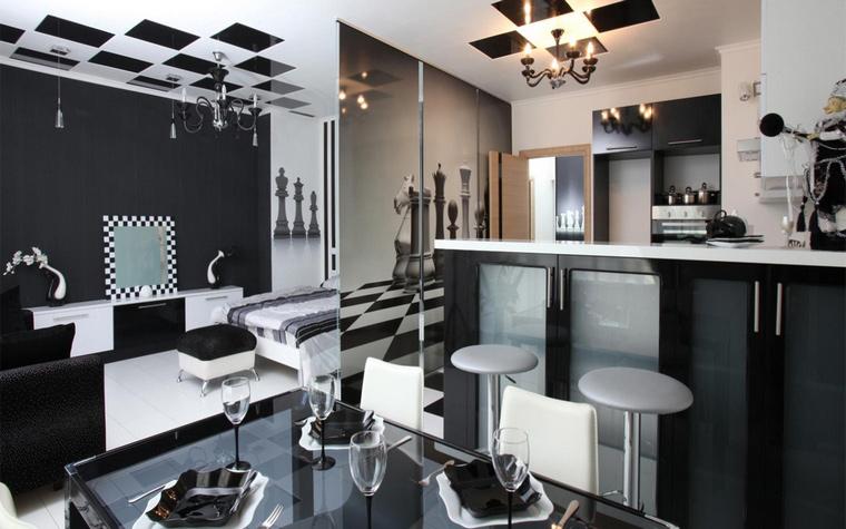 <p>Автор проекта: Юлия Кацьянова</p> <p>&quot;Шахматная&quot; расцветка черно-белой кухни - оммаж Людовикам!</p>