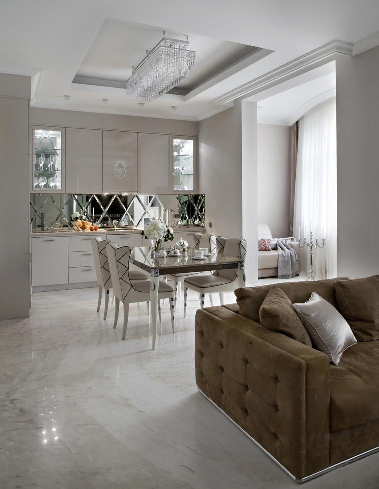 <p>Автор проекта:   Mill-Studio</p> <p>Белая палитра, светлые тона - это, конечно, очень изысканно и стильно. Однако, такой проект энергозатратен, и в смысле поддержания чистоты - тоже. </p>